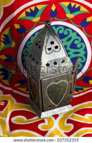 Islamic lantern on Egyptian decorations fabric (khyamia fabrics) - stock photo
