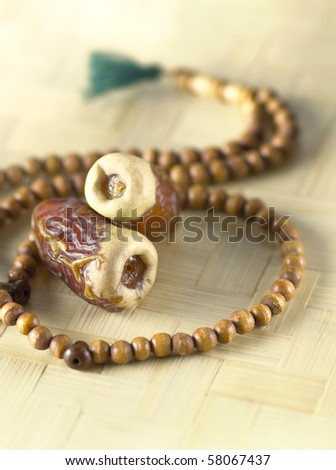 Islamic Rosary and tow dates - stock photo