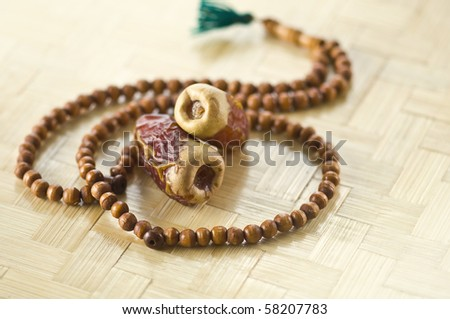 Islamic rosary and two dates. - stock photo