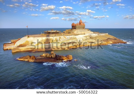 Island at ocean near Cape Comorin in Kanyakumari, the most southern point of india. - stock photo