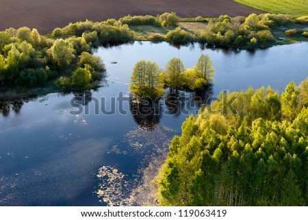 Island in a river, aerial view, Lithuanian nature. - stock photo