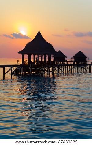 Island in ocean, Maldives.  Sunset. - stock photo