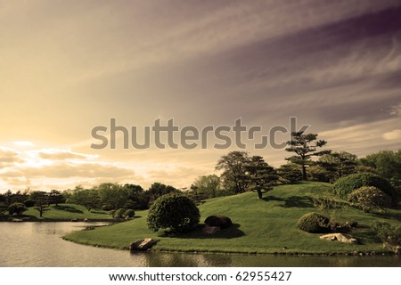 island in pond with asian-inspired  landscaping  (sepia) - stock photo