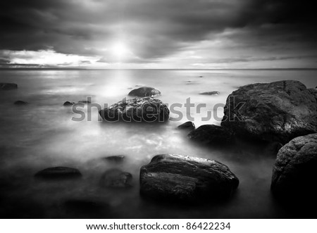Island in the sunset - stock photo