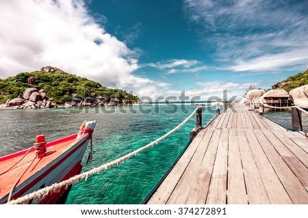 Island of dreams . Island lengthwise of the bridge .Water bridge and the sky. - stock photo
