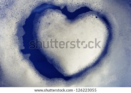 Island of heart made from soap foam - stock photo