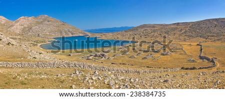 Island of Krk yachting bay safe harbour in stone desert, Croatia - stock photo