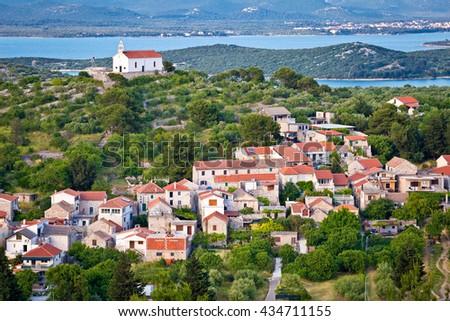 Island of Murter village and hill church, historic heritage view, Dalmatia, Croatia - stock photo