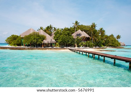 Island of Paradise! White sand beaches with coco-tree and crystal blue water. - stock photo
