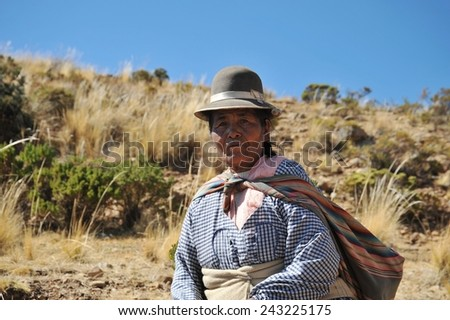 ISLAND OF THE MOON, BOLIVIA - SEPTEMBER 4, 2010 : Island  of the Moon is located on lake Titicaca. At the time of the Incas lived here in seclusion young women. Unknown woman on the island of the Moon