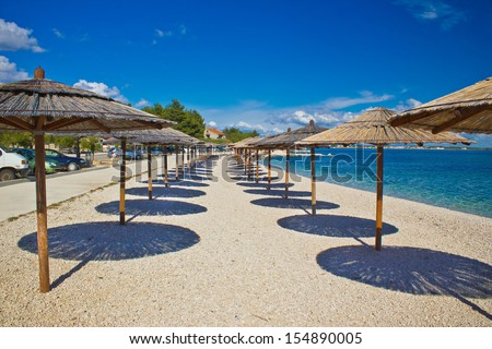 Island of Vir beach umbrellas, Dalmatia, croatia - stock photo