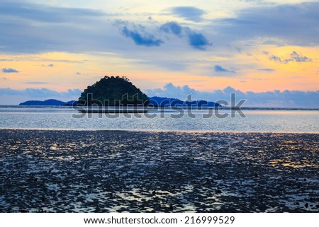 Island on sea with sunset sky at Pak Meng beach, Trang, Thailand