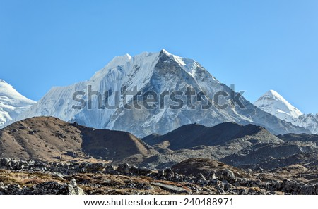 Island peak (6189 m) in the valley Chhukhung in district Mount Everest - Nepal, Himalayas - stock photo