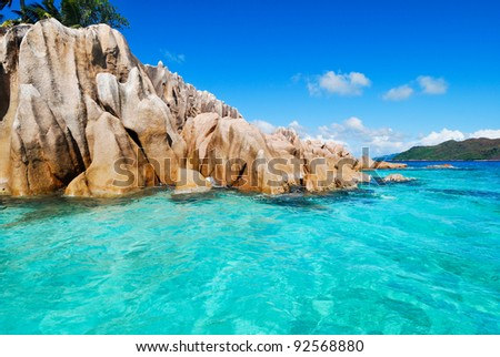 Island view from the ocean. Blue ocean - stock photo