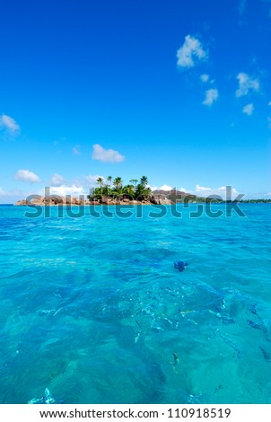Island view from the ocean, the Seychelles - stock photo