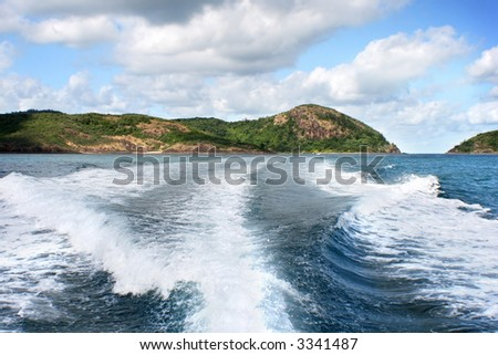 island view with clouds in the sky and ocean - stock photo