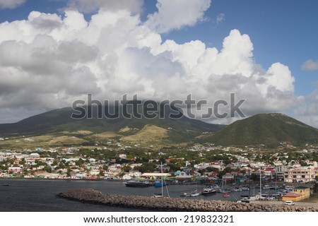 Island volcano and clouds. Saint Kitts, Federation Saint Christopher and Nevis - stock photo