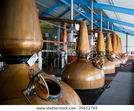 Islay whisky distillery stills - stock photo