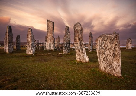 Isle of Lewis, Scotland: Callanish standing stones (a neolithic stone circle) at sunset - stock photo