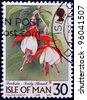 ISLE OF MAN - CIRCA 1998: A stamp printed in Isle of Man shows fuchsia, lady thumb, circa 1998 - stock photo