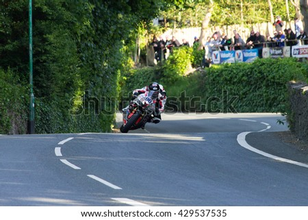 ISLE OF MAN, UK - MAY 31 2016: riders undertake qualifying laps of the annual TT (Tourist Trophy)  Union Mills.