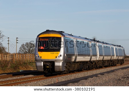 ISLIP, UK - DECEMBER 9: A Chiltern operated outer London commuter service heads toward Oxford on a new stretch of track on December 9, 2015 in Islip. Chiltern operate a fleet of 87 units over 336Km