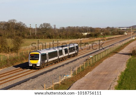 ISLIP, UK - DECEMBER 9: A Chiltern Railways class 168 diesel unit heads towards Oxford Parkway on the newly opened piece of track that connects Oxford with Bicester on December 9, 2015 in Islip