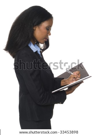 Isloated full length studio shot of an African American woman writing on her notepad.