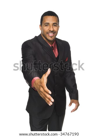 Isloated studio shot of an African American businessman reaching out to the camera to shake hands.