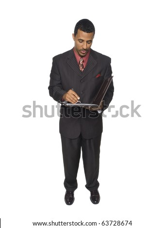 Isloated studio shot of an African American man looking down as he writes on a clipboard he is holding.