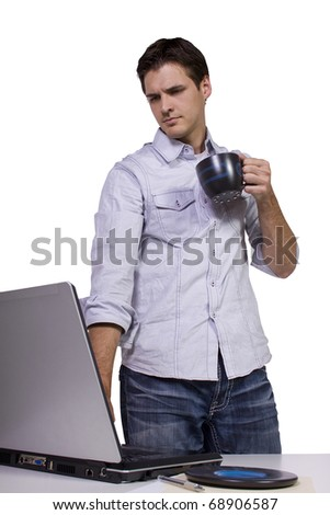 Isoalted Young Businessman drinking coffee and working on laptop - stock photo