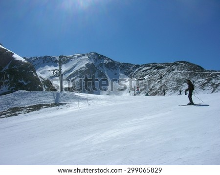 ISOLA, FRANCE - MARCH 26, 2012: Skiers on the ski runs in ISOLA 2000, a French ski resort in the southern French Alps, located about 90 km from Nice, on an sunny morning. - stock photo