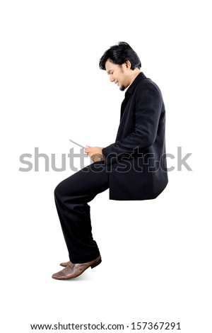 isolate asian business mand sitting on the air - stock photo