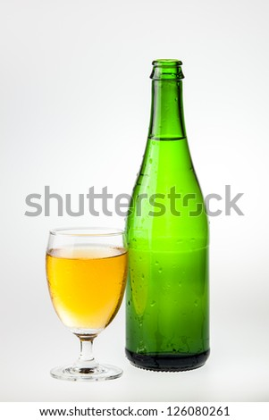 Isolate glass and bottle of wine with water drop outside against white background