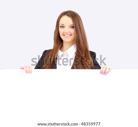 Isolate of a business woman standing beside a blank board