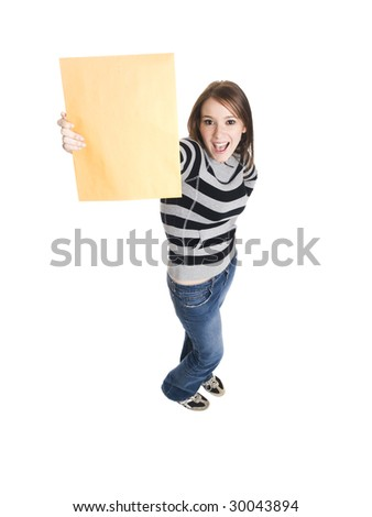 Isolate studio shot of a casually dressed young adult woman grinning as she holds up a manila envelope. - stock photo