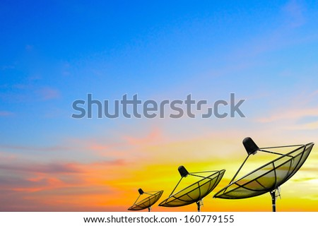 isolate tree satellite dishes over sunset, use as background - stock photo