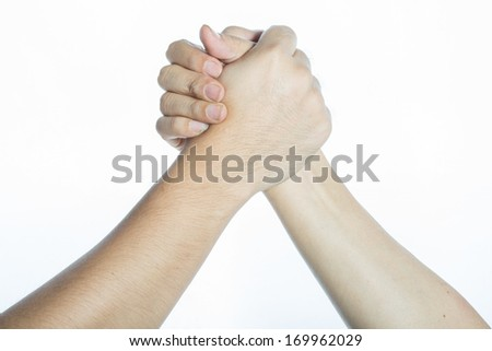 isolate two hands holding on another, signal of collaboration - stock photo