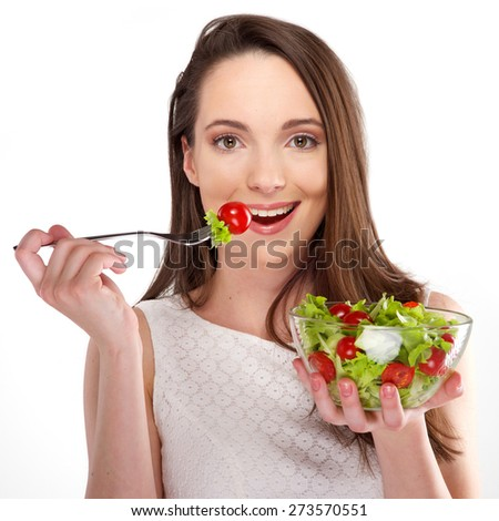 isolated a beautiful girl eating healthy food on white background - stock photo