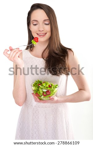 isolated a beautiful girl with salad on white background