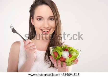 isolated a beautiful girl with salad on white background - stock photo