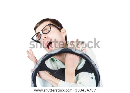 Isolated accident prone man in the throes of a car crash impact. Uncoordinated drivers - stock photo