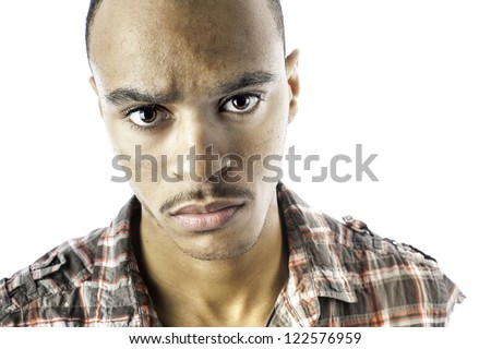 Isolated african american young male with a serious look - stock photo