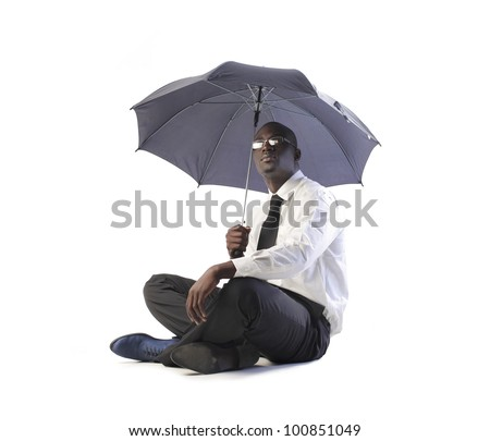 Isolated african businessman under an umbrella - stock photo