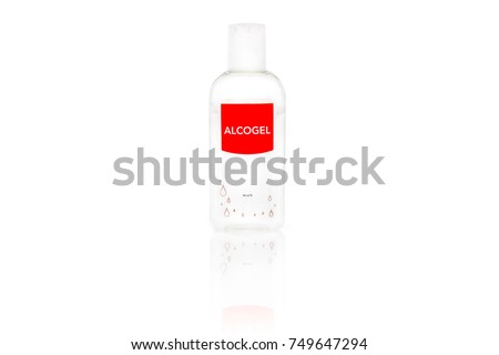 Isolated alcogel hand disinfectant in a small plastic bottle with red label, studio shot on white background.