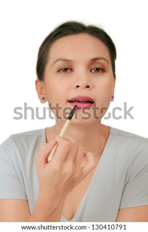 Isolated an asian middle age woman with make up on the lips - stock photo