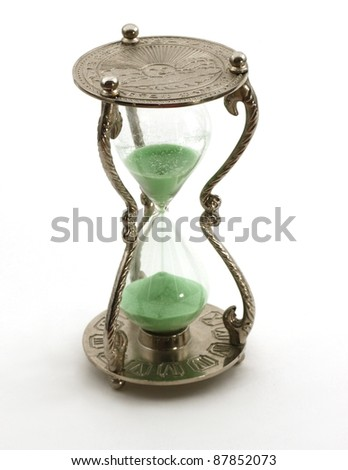 Isolated antique hourglass; concept of time passing - stock photo