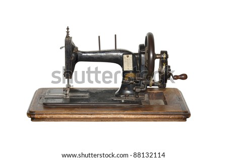 isolated antique sewing machine on white - stock photo