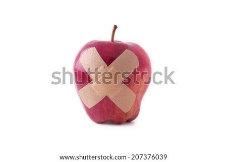 Isolated apple with band-aid - stock photo