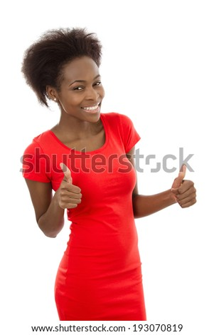 Isolated attractive african woman in red with thumbs up. - stock photo